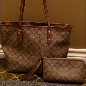 Brown Coach tote with matching wristlet wallet